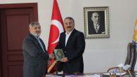 İlçe Müftüsü Türkoğlu Arifiye Belediyesinde Kuran-ı Kerim dağıttı