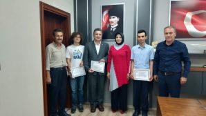 Dünya Bilim Olimpiyatı Şampiyonlarına Takdir Belgesi